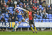 Reading FC defender (35) Jake Cooper wins the header ahead of Birmingham City striker (9) Clayton Donaldson during the Sky Bet Championship match between Reading and Birmingham City at the Madejski Stadium, Reading, England on 9 April 2016. Photo by Mark Davies.