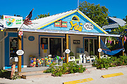 Souvenir and watersports equipment shop Yolo with adirondack chairs and hammock in downtown Captiva Island in Florida, USA