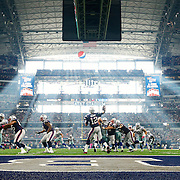 New England Patriots quarterback Tom Brady (12) drops back to pass as light comes into AT&T Stadium during the NFL regular season game against the Dallas Cowboys on Sunday, Oct. 11, 2015 in Arlington, Texas. The Patriots won, 30-6. (Ric Tapia via AP)