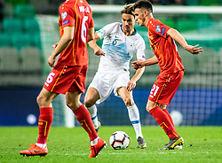 Rene Krhin of Slovenia vs Visar Musliu of Macedonia and Eljif Elmas of Macedonia during football match between National teams of Slovenia and North Macedonia in Group G of UEFA Euro 2020 qualifications, on March 24, 2019 in SRC Stozice, Ljubljana, Slovenia.  Photo by Matic Ritonja / Sportida
