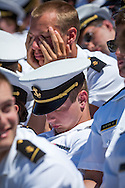 Members of the US Naval Academy fall asleep  during the Graduation/Commissioning Ceremony at the United States Naval Academy on Friday May 22, 2015. (Alan Lessig/Staff)
