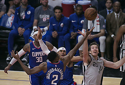 November 15, 2018 - Los Angeles, California, U.S - Jakob Poeltl #25 of the San Antonio Spurs and Shai Gilgeous-Alexander #2 of the Los Angeles Clippers reach for the ball during their NBA game on Thursday November 15, 2018 at the Staples Center in Los Angeles, California. (Credit Image: © Prensa Internacional via ZUMA Wire)