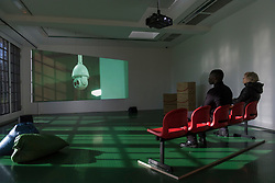 """© Licensed to London News Pictures. 03/03/2020. LONDON, UK.  Visitors view """"Whose Utopia"""", 2006, a video by Cao Fei.  Preview of """"Blueprints"""" by Cao Fei, a Chinese multi-media artist and filmmaker, based in Beijing.  The exhibition is the artist's first large-scale solo show in the UK, features works from 2006-2020 including her first virtual reality work. The show takes place at the Serpentine Gallery 4 March to 17 May 2020.  Photo credit: Stephen Chung/LNP"""