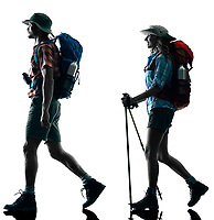 one caucasian couple trekker trekking walking nature in silhouette isolated on white background