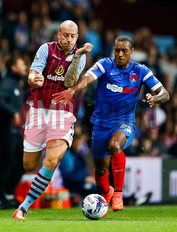 Alan Hutton of Aston Villa and Jay Simpson of Leyton Orient compete for the ball - Photo mandatory by-line: Rogan Thomson/JMP - 07966 386802 - 27/08/2014 - SPORT - FOOTBALL - Villa Park, Birmingham - Aston Villa v Leyton Orient - Capital One Cup Round 2.