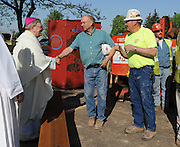 Bishop David Ricken greets construction workers outside Bosco Hall following a blessing of the construction site May 22. The building located at the diocesan offices in Allouez is undergoing major renovation in preparation for relocation of diocesan employees from the chancery office. (Sam Lucero | The Compass)