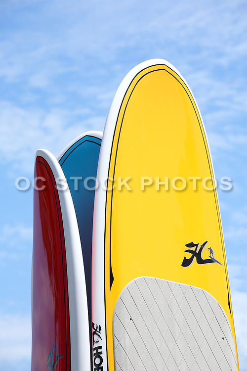 Red, Yellow, And Blue Stand Up Paddle Boards