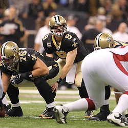 16 January 2010:  New Orleans Saints quarterback Drew Brees (9) under center during a 45-14 win by the New Orleans Saints over the Arizona Cardinals in a 2010 NFC Divisional Playoff game at the Louisiana Superdome in New Orleans, Louisiana.