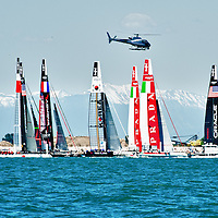 America's Cup  World Series  in Venice first day of races sees Energy Team at the top. On the background the Alps covered with snow