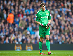 14.12.2013, Etihad Stadium, Manchester, ENG, Premier League, Manchester City vs FC Arsenal, 16. Runde, im Bild Manchester City's goalkeeper Costel Pantilimon looks dejected as Arsenal score the first equalising goal the // during the English Premier League 16th round match between Manchester City and Arsenal FC at the Etihad Stadium in Manchester, Great Britain on 2013/12/14. EXPA Pictures &copy; 2013, PhotoCredit: EXPA/ Propagandaphoto/ David Rawcliffe<br /> <br /> *****ATTENTION - OUT of ENG, GBR*****