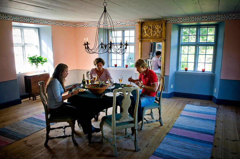 Eva Darpö eating lunch with her son X and his girlfriend Y in their  summer home in Bunge, Gotland...Photographer: Chris Maluszynski /MOMENT
