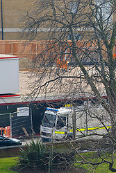 © Licensed to London News Pictures. 23/03/2015. LONDON, UK. Police officers and Royal Bomb Disposal Unit securing the area, where a suspected unexploded WWII bomb was discovered by builders at The Grange in Southwark, London on Monday 23 March 2015. The unexploded bomb is thought to be approximately 5ft long and 1000lbs in weight. Photo credit : Tolga Akmen/LNP