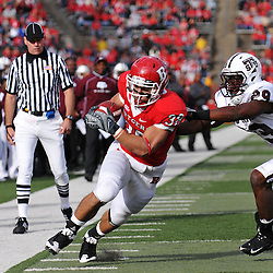Oct 10, 2009; Piscataway, NJ, USA; Rutgers running back Joe Martinek (38) avoids the tackle attempt by Texas Southern safety Jashaad Gaines (29) on his way into the end zone during first half NCAA college football action between Rutgers and Texas Southern at Rutgers Stadium.