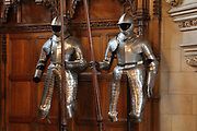 Suits of armour in James IV's Great Hall, 1503-13, the chief assembly hall in the castle, on Crown Square, in Edinburgh Castle on Castle Rock, Edinburgh, Scotland. The Great Hall was used as a military barracks in the 17th and 18th centuries and as a military hospital in the 19th century, then restored by Hippolyte Blanc, 1844-1917, to medieval style. The first royal castle built here was under David I in the 12th century, and the site has been built on, attacked and defended ever since. The castle now houses military museums and the National War Museum of Scotland and is run by Historic Scotland. Picture by Manuel Cohen
