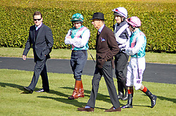 Sir Henry Cecil, 10-time champion trainer, has died at the age of 70.<br /> Responsible for 25 British Classic winners, Cecil was also the leading handler at Royal Ascot with a record 75 successes.<br /> Sir Henry Cecil tracked by Danny Dunnachie (2nd left) Shane Fetherstonhaugh (2nd right) and Tom Queally (right) before the Frankel gallop Newmarket 29 Sep 2012.<br /> Photo by: Racingfotos.com / i-Images.