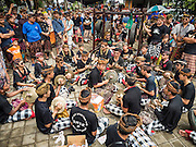 16 JULY 2016 - UBUD, BALI, INDONESIA:  A gamelan orchestra performs at the site of the mass cremation in Ubud. Local people in Ubud exhumed the remains of family members and burned their remains in a mass cremation ceremony Wednesday. Almost 100 people were cremated and laid to rest in the largest mass cremation in Bali in years this week. Most of the people on Bali are Hindus. Traditional cremations in Bali are very expensive, so communities usually hold one mass cremation approximately every five years. The cremation in Ubud concluded Saturday, with a large community ceremony.    PHOTO BY JACK KURTZ