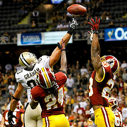 September 9, 2012; New Orleans, LA, USA; New Orleans Saints tight end Jimmy Graham (80), Washington Redskins safety DeJon Gomes (24) and cornerback DeAngelo Hall (23) reach for a pass during the fourth quarter of a game at the Mercedes-Benz Superdome. The Redskins defeated the Saints 40-32. Mandatory Credit: Derick E. Hingle-US PRESSWIRE