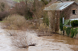 © Licensed to London News Pictures. 14/03/2019. Builth Wells, UK. After more heavy rain last night, the river Wye bursts it's banks at Builth Wells in Powys. Photo credit: Graham M. Lawrence/LNP