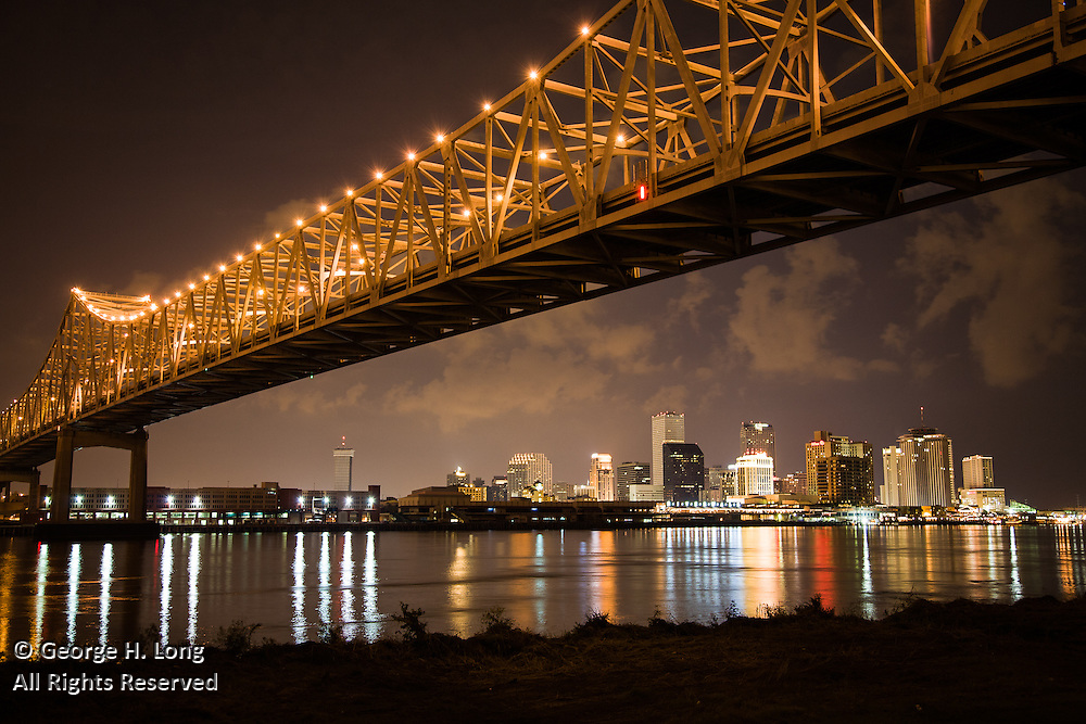 Greater New Orleans Mississippi River Bridge and downtown New Orleans skyline view from Westbank at night