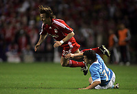 Photo: Paul Thomas.<br /> Liverpool v PSV Eindhoven. UEFA Champions League. Quarter Final, 2nd Leg. 11/04/2007.<br /> <br /> Dirk Marcellis (Blue) of PSV is sent off for this tackle on Bolo Zenden.