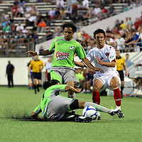 Puerto Rico United Forward Mauricio Andres Turizo Pulido (9) and Orlando City Lions MIdfielder Lewis Neal (24) chase the ball during a United Soccer League Pro soccer match between Puerto Rico United and the Orlando City Lions at the Florida Citrus Bowl on April 22, 2011 in Orlando, Florida.  (AP Photo/Alex Menendez)