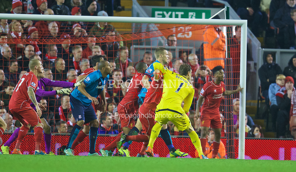 LIVERPOOL, ENGLAND - Saturday, November 29, 2014: Stoke City's goalkeeper Asmir Begovic challenges for a corner against Liverpool during the Premier League match at Anfield. (Pic by David Rawcliffe/Propaganda)