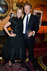 Editor of Tatler KATE REARDON and HUGO BURNAND at an exhibition of the 50 best party pictures from Tatler from the past 50 years, held at Annabel's, Berkeley Square, London on 9th September 2013.