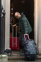 © Licensed to London News Pictures. 20/12/2019. London, UK. Special advisor to Boris Johnson DOMINIC CUMMINGS walks up Downing St carrying luggage. Photo credit: Ray Tang/LNP