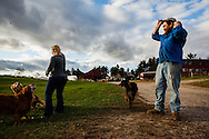 Harry Weiser, owner of Hackleboro Orchard in Canterbury, watches his daughter Krista Weiser throw a stick for his dogs on Friday, October 18, 2013.