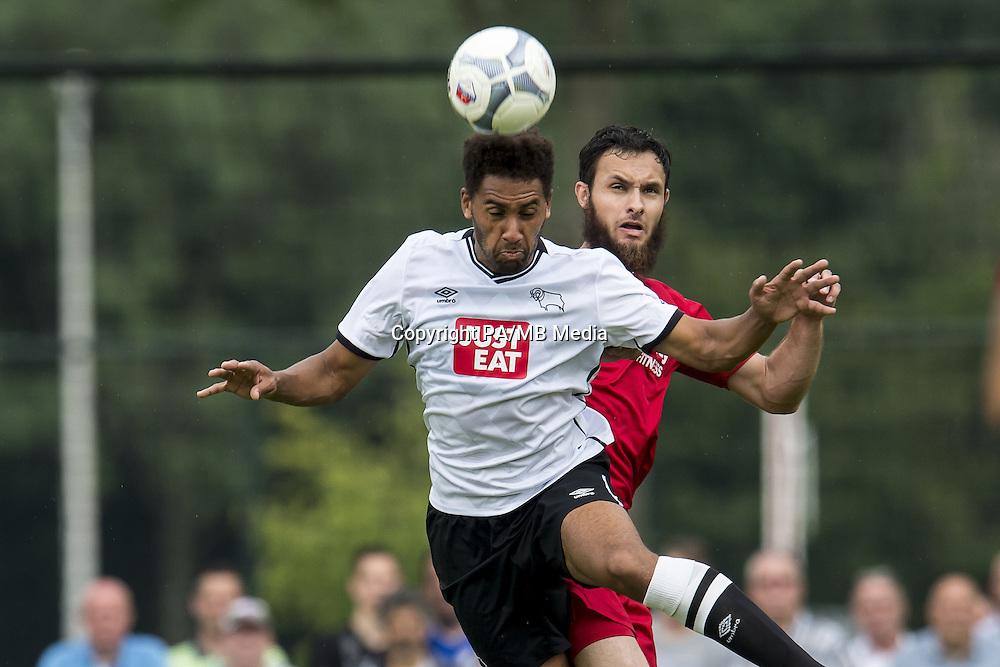 (L-R) Ryan Shotton of Derby County, Nacer Barazite of FC Utrecht