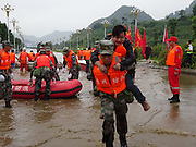 BIJIE, CHINA - JUNE 28: <br /> <br /> Rescue work in the flood caused by heavy rain in Zhijin County on June 28, 2016 in Bijie, Guizhou Province of China. Over 10 hours continuous heavy rain caused 2 people died, 1 still missing and the direct economic loss of 115.62 million yuan (about 17.39 million USD) till Tuesday in Zhijin County, Guizhou Province. <br /> ©Exclusivepix Media