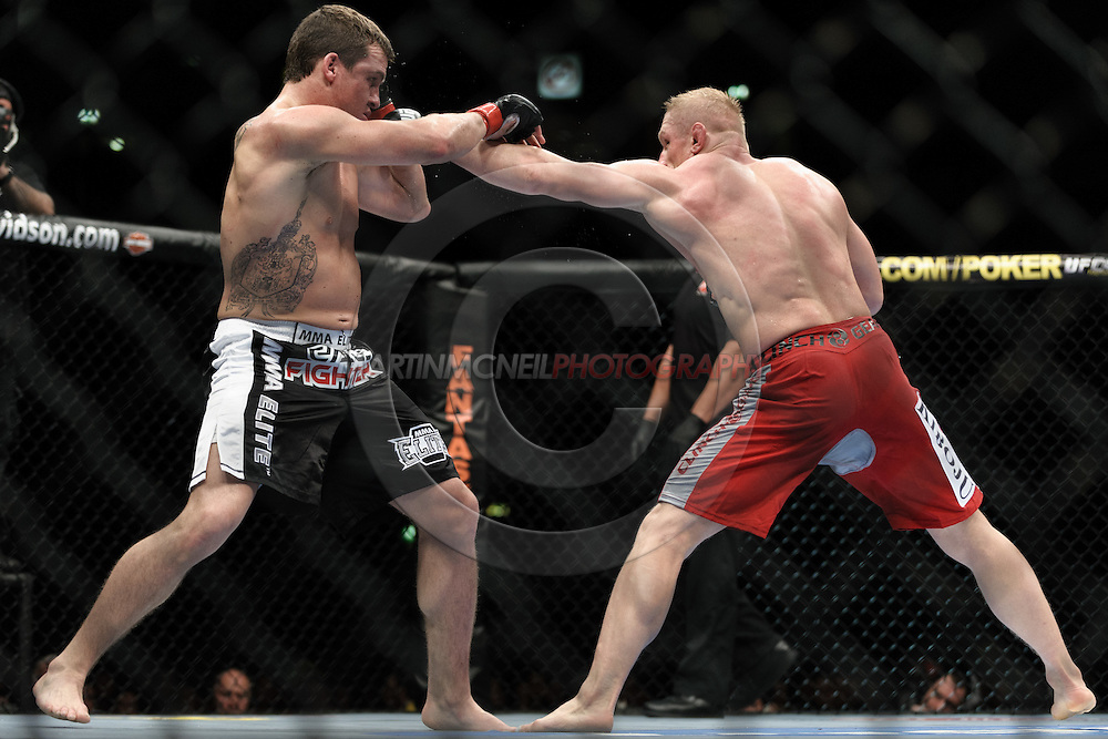 "MANCHESTER, ENGLAND, NOVEMBER 14, 2009: Paul Kelly (left) and Dennis Siver during ""UFC 105: Couture vs. Vera"" inside the MEN Arena in Manchester, United Kingdom."