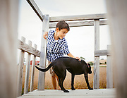 A boy playing with his dog. Various farms in Johnson and Iowa County, Iowa.<br /> Country lifestyle.<br /> Photographed by editorial lifestyle photographer Nathan Lindstrom<br /> <br /> Nathan Lindstrom Photography<br /> <br /> © 2015 Nathan Lindstrom