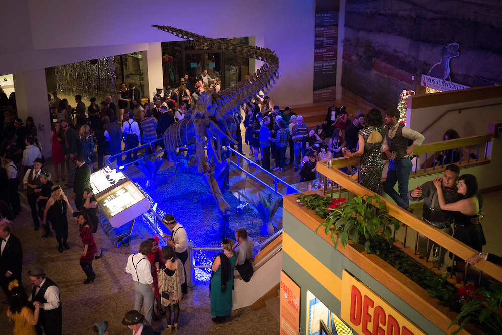 Decked out in 20's attire, party goers fill the Natural History Museum on New Year's Eve for the Roaring 20's themed celebration, Albuquerque, New Mexico.