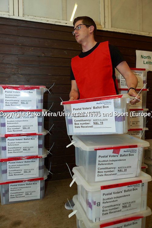 Jonathan Parker working with boxes of envelop for the Scotland referendum in the Highland Centre.<br /> Potocall as postal votes processed. Edinburgh council workers begin to verify the first votes submitted by post at Royal Highland Centre, Ingliston<br /> Pako Mera/Universal News And Sport (Europe) 12/09/2014