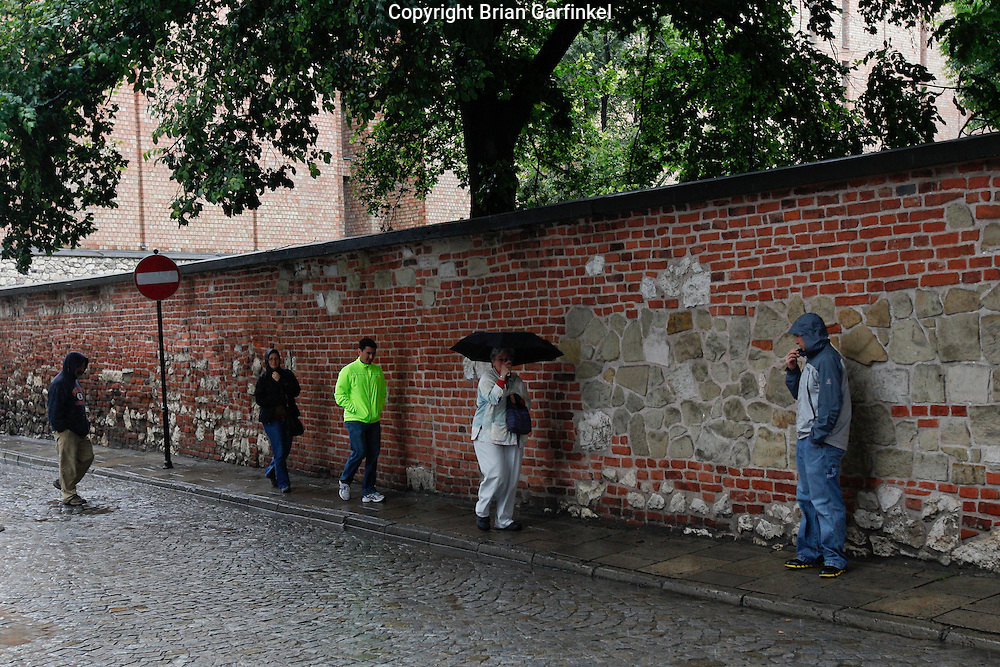 Dad, Kate, Jesus, Mom, and Joel walk in the rain in Krakow, Poland on Monday July 4th 2011.  (Photo by Brian Garfinkel)