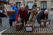 14/04/2018. Coffins containing the bodies of victims of Spain Civil War exhumed in Cobertelada and Calatañazor are placed a bench in the center of Soria during a homage to hand the remains to their relatives on April 14, 2018 in Soria, Spain. La Asociacion Soriana Recuerdo y Dignidad (ASRD) 'The Soria Association for Memory and Dignity' celebrated a tribute to hand over the remains of civil war victims to their families. The Society of Sciences of ARANZADI helped with the research, exhumation and identification of the bodies, after villagers passed the information about the mass grave, 81 years after the assassination took place, to the ASRD. Seven people were assassinated around August 25, 1936 by Falangists, as part of General Francisco Franco armed forces, and buried in the 'Fosa de los Maestros' (Teachers Mass Grave) near Cobertelada, Soria, after being taken from prison of Almazan during the Spanish Civil War. Five of them were teachers in the region, and also friends of Spanish writer Antonio Machado. The other two still remain unidentified. Another body was assassinated by Falangists accompanied by a priest in 1936, and was exhumed on 23 September of 2017 near Calatañazor, Soria. It belonged to Abundio Andaluz, a politician, lawyer and musician in Soria.<br /> Spain's Civil War took the lives of thousands of people on both sides, and civilians. But Franco continued his executions after the war has finished. Teachers, as part of the education sector, were often a target of Franco's forces. Spanish governments has never done anything to help the victims of the Civil War and Franco's dictatorship while there are still thousands of people missing in mass graves around the country. (© Pablo Blazquez)