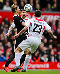 Fernando Torres under pressure from Jamie Carragher and Alberto Moreno - Photo mandatory by-line: Matt McNulty/JMP - Mobile: 07966 386802 - 29/03/2015 - SPORT - Football - Liverpool - Anfield Stadium - Gerrard's Squad v Carragher's Squad - Liverpool FC All stars Game