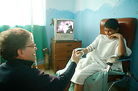 """Al Franken playing """"thumb war"""" with a twelve year old boy, at the US Military Hospital in Baghdad's Green Zone Al Franken, USO tour"""