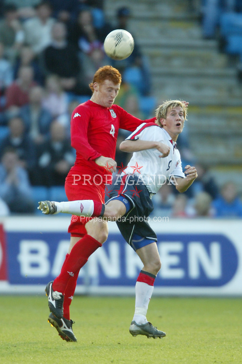 OSLO, NORWAY - Thursday, May 27, 2004:  Wales' James Collins and Norway's Thorstein Helstad during the International Friendly match at the Ullevaal Stadium, Oslo, Norway. (Photo by David Rawcliffe/Propaganda)