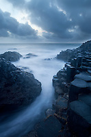 As the sun fades the moving surf gives a mystical feel to the coast of the island known as Eire. Portrush, Northern Ireland