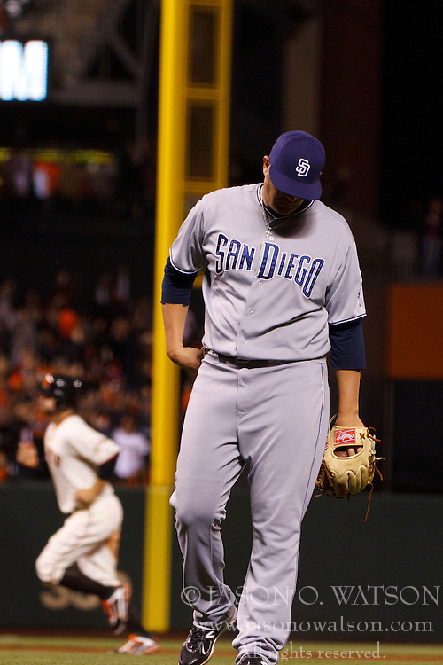 September 12, 2011; San Francisco, CA, USA;  San Diego Padres relief pitcher Andrew Carpenter (37) reacts after giving up a three run home run to San Francisco Giants third baseman Pablo Sandoval (not pictured) during the seventh inning at AT&T Park.