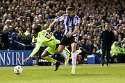 Brighton defender, full back, Gaetan Bong (12)  is fouled by Sheffield Wednesday striker Marco Matias (7)  during the Sky Bet Championship play-off first leg match between Sheffield Wednesday and Brighton and Hove Albion at Hillsborough, Sheffield, England on 13 May 2016. Photo by Simon Davies.