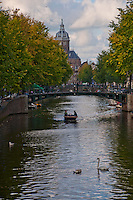 Amsterdam, Holland. On a boat going down the canal towards the Church of St. Nicholas.