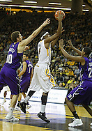 January 12 2010: Iowa Hawkeyes forward Melsahn Basabe (1) puts up a shot between Northwestern Wildcats forward Davide Curletti (30) and Northwestern Wildcats guard JerShon Cobb (23) during the first half of an NCAA college basketball game at Carver-Hawkeye Arena in Iowa City, Iowa on January 12, 2010. Northwestern defeated Iowa 90-71.