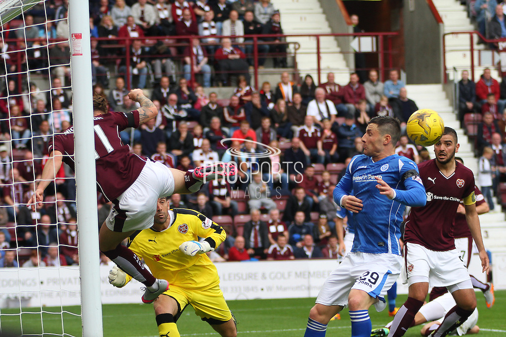 Sam Nicholson makes a vital goal line clearance during the Ladbrokes Scottish Premiership match between Heart of Midlothian and St Johnstone at Tynecastle Stadium, Gorgie, Scotland on 2 August 2015. Photo by Craig McAllister.
