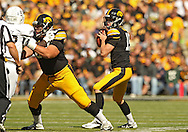 September 21 2013: Iowa Hawkeyes quarterback Jake Rudock (15) looks to throw during the first quarter of the NCAA football game between the Western Michigan Broncos and the Iowa Hawkeyes at Kinnick Stadium in Iowa City, Iowa on September 21, 2013. Iowa defeated Western Michigan 59-3.