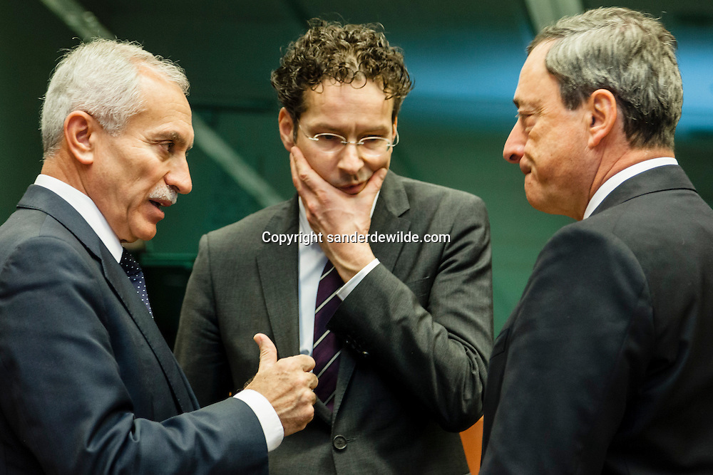 (From L) The minister of Finance of Cyprus, Vassos Shiarly tries convincing Dutch Finance Minister and President of the Eurogroup Council Jeroen Dijsselbloem (middle) and President of the ECB.Mario Draghi before an Eurogroup Council meeting on February 11, 2013 at the European Union Headquarters in Brussels. Dijsselbloem holds his first eurozone meeting today, with Cyprus and Greece on the agenda.