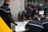 Calais, Pas-de-Calais, France - 25.10.2016    <br />  <br /> Refugees and migrants at the registration shelter. After registration, they are taken by bus to various camps in whole France. 2nd day of the eviction on the so called &rdquo;Jungle&quot; refugee camp on the outskirts of the French city of Calais. Many thousands of migrants and refugees are waiting in some cases for years in the port city in the hope of being able to cross the English Channel to Britain. French authorities announced a week ago that they will evict the camp where currently up to up to 10,000 people live.<br /> <br /> Fluechtlinge und Migranten in der Registrierungszone. Nach der Registrierung werden sie mit Bussen auf Camps in ganz Frankreich aufgeteilt. Zweiter Tag der Raeumung des so genannte &rdquo;Jungle&rdquo;-Fluechtlingscamp in der franz&ouml;sischen Hafenstadt Calais. Viele tausend Migranten und Fluechtlinge harren teilweise seit Jahren in der Hafenstadt aus in der Hoffnung den Aermelkanal nach Gro&szlig;britannien ueberqueren zu koennen. Die franzoesischen Behoerden kuendigten vor einigen Wochen an, dass sie das Camp, indem derzeit bis zu bis zu 10.000 Menschen leben raeumen werden. <br /> <br /> Photo: Bjoern Kietzmann