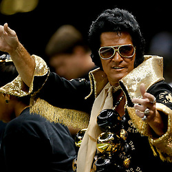 Aug 16, 2013; New Orleans, LA, USA; A New Orleans Saints fan dressed as Elvis in the stand during the first quarter of a preseason game against the Oakland Raiders at the Mercedes-Benz Superdome. Mandatory Credit: Derick E. Hingle-USA TODAY Sports